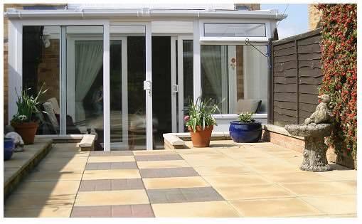Kitchen conservatory benefits kitchen conservatories for Conservatory sliding doors
